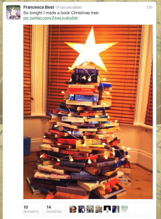A Christmas Tree made of books.