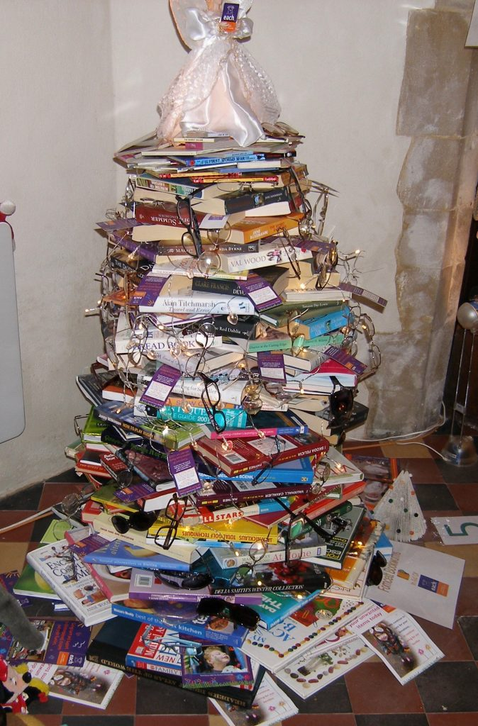 A Christmas tree made out of books.